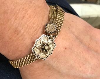 Vintage 14k yellow gold enamel pearl slide tassel bracelet with slide size adjustment. 13.20dwt