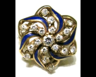 Antique 14k gold diamonds and blue enamel. Center stone is approx .11 carats and surronded by 18 diamonds totaling .9 carats. Sz 6.5 9.57 g
