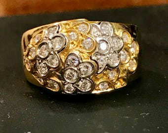 18k yellow and white gold floral diamond dome ring. Sz 6, 7.36dwt. .47ctw of diamonds.