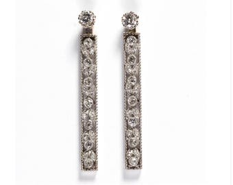 "Vintage 14k white gold and diamond earrings. Approximately 1.20 ctw of diamonds. 6.8 dwt. 1 3/4"" long."
