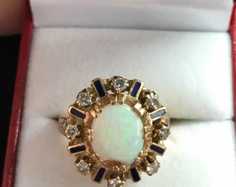 14k yellow gold opal and diamond enamel ring. Sz 9.5, weight 7.9g (opal has a chip.)