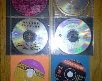 Rock cds Total 6 Journey,Eagles,Lynyrd Skynrd,AC/DC,Led Zepplin,CCR
