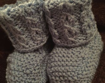 Hand knitted Cable baby booties.