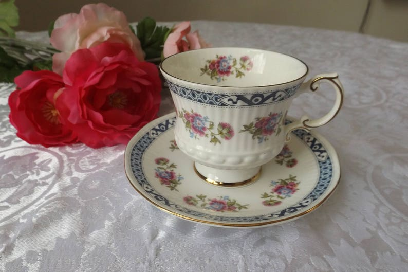 Delightful English Elizabethan floral bone china tea or coffee set service  1 cup & 1 matching saucer Floral design New old stock  Gift idea