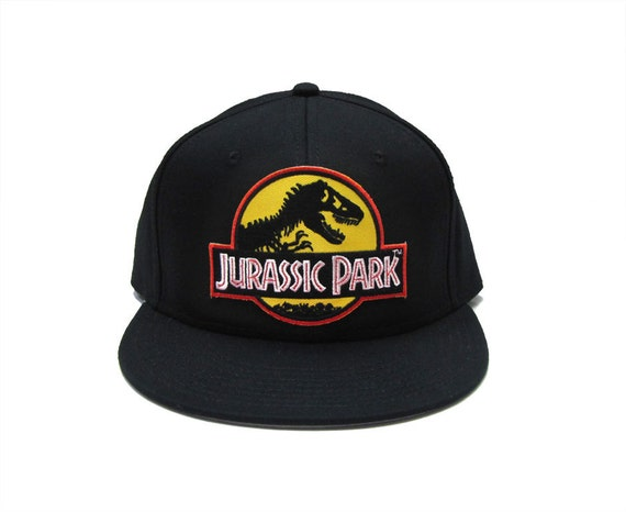 e98f04dd2c4 Jurassic Park Movie Logo Yellow Patch Flat Bill Snapback Black