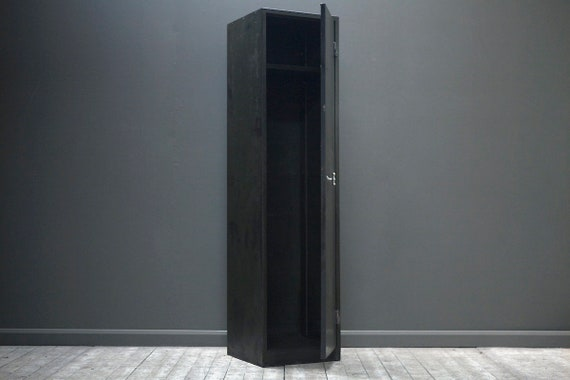 A customisable single door vintage industrial locker with brass T knob.