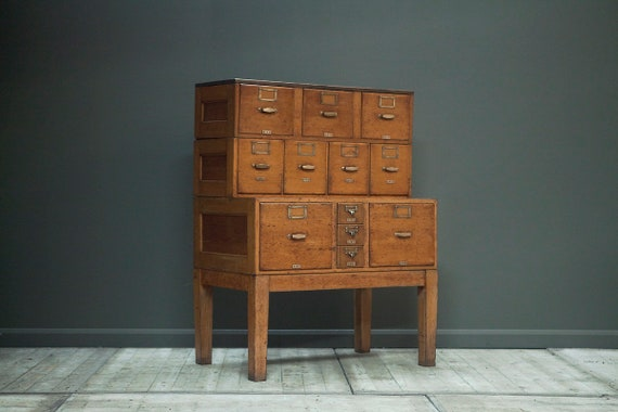 A vintage filing or stationary cabinet on legs
