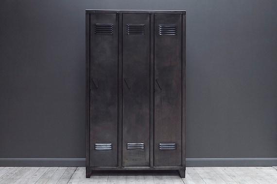 Vintage, industrial steel locker wardrobe  with three doors. Guide price only.