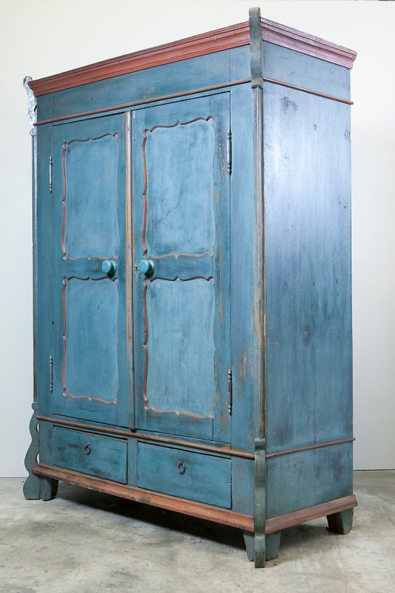 19th century, continental, blue (as found) painted two door armoire
