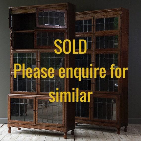 Antique oak bookcase by Minty.