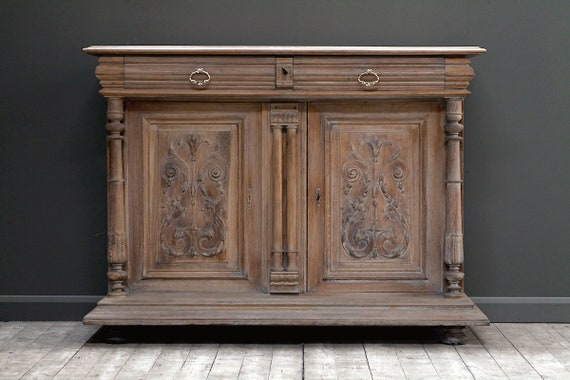 French, ornately carved buffet cabinet, circa 1850's.