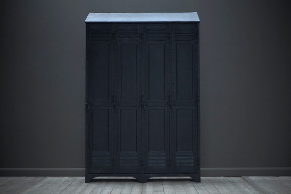 An industrial vintage, four door locker with custom made shelving