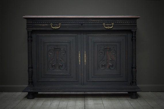 A french, ornately carved, ebonized, cabinet or dresser