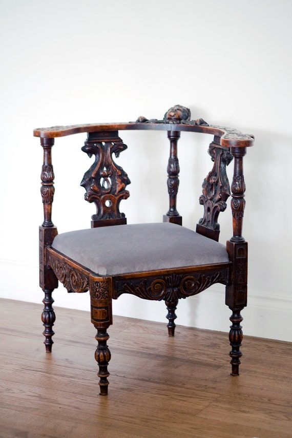 19th century carved corner grey chair. MAKE AN OFFER. Guide price only.