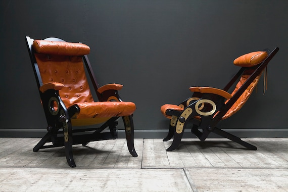 A pair of reclining campaign or cruise chairs designed by Herbert McNair