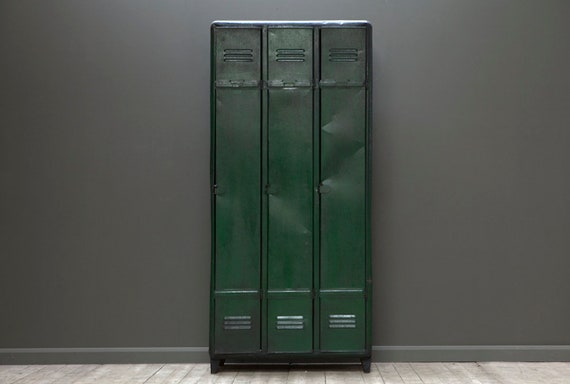 A customisable vintage, industrial, three door locker in green.