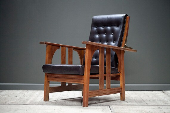 An early - mid century reclining  Morris chair in oak and leather