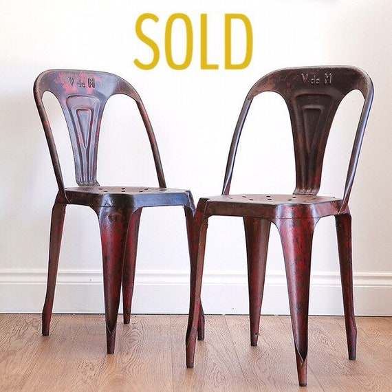 Pair of french bistro metal chairs by Joseph Mathieu