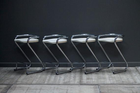 A set of four original vintage steel and chrome Borge Lindau bar stools