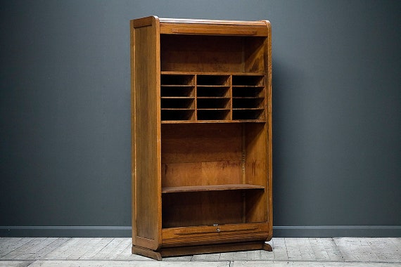 A haberdashery cabinet with lockable tambour door