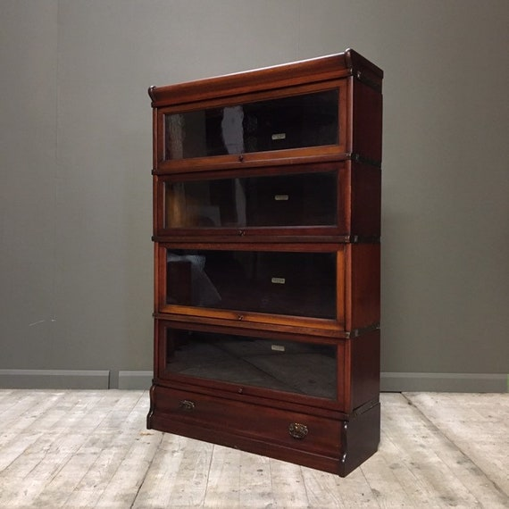 Bookcase, stacking, by Oak Globe Wernicke, four sections and a long drawer.  Guide price only.