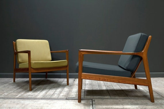 A pair of USA 75 Armchairs by Folke Ohlsson for Dux, 1950s (reupholstered to specification).