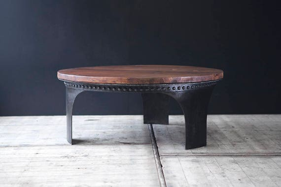 Round water tank coffee table with customisable wood top