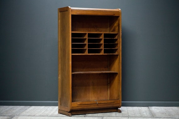 A haberdashery cabinet with lockable tambour doors