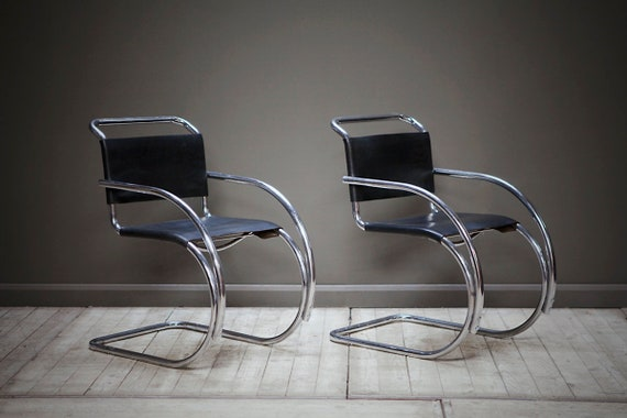 A set of two original MR20 cantilever chairs by Mies Van De Rohe.