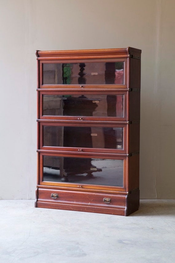 Bookcase, stacking, by Oak Globe Wernicke, five sections and a long drawer.  MAKE AN OFFER. Guide price only.