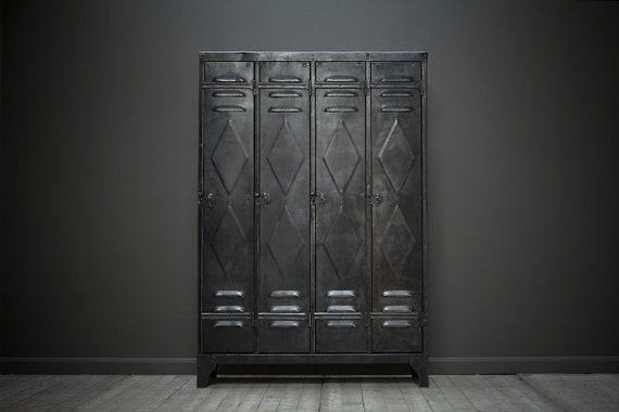 An original restored industrial vintage locker with four doors