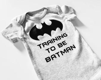 Training to be BATMAN onesie.