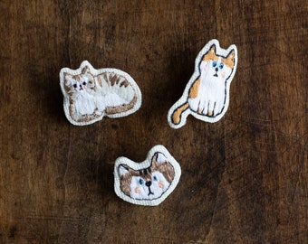 Embroidered brooches - cats