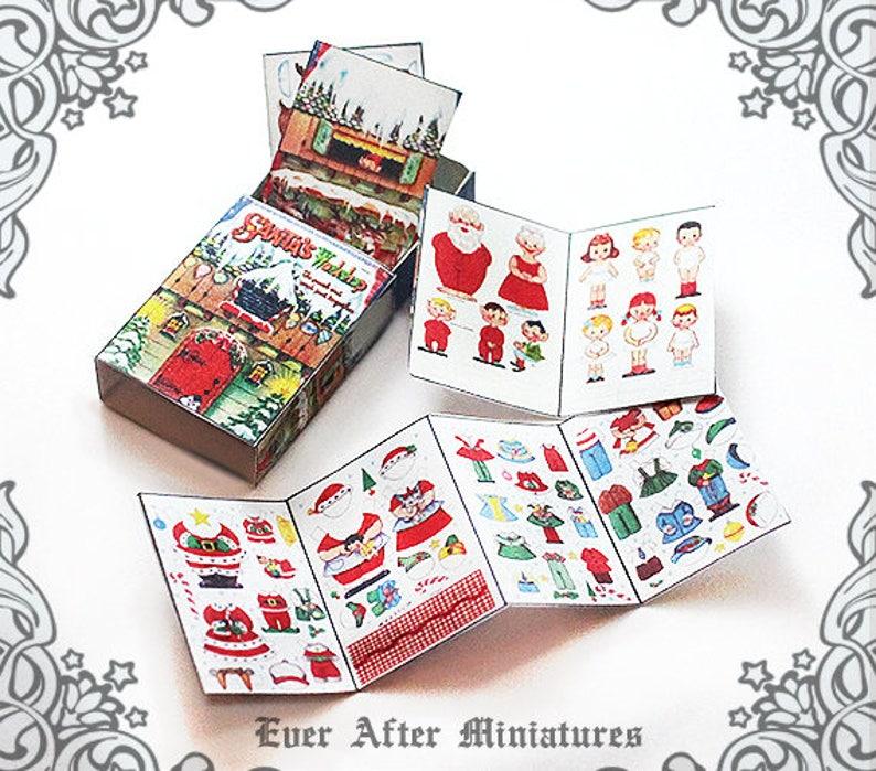 photograph regarding Printable Dollhouse titled 1:12 SANTA WORKSHOP Paper Doll Activity Box Printable Dollhouse Miniature Santa Paper Doll Santa Claus Xmas Matchbox Paperdoll Obtain