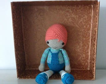 Crochet Boy with fixed dresses and security eyelets.