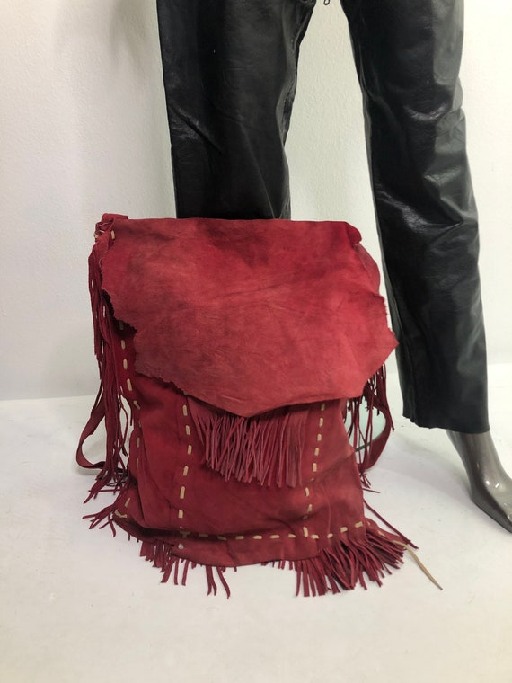 Red real suede crossbody bag with fringe with pock