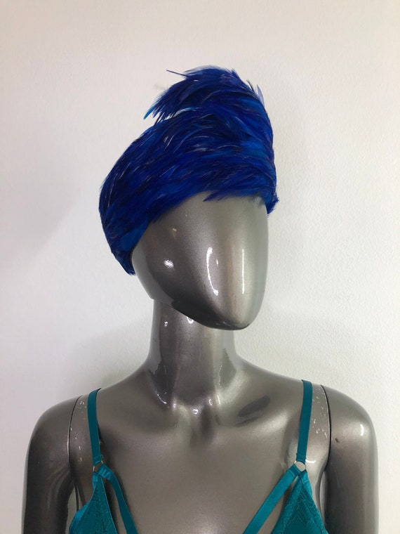 Blue fashion feather hat woman.
