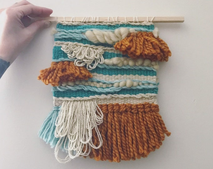 Hand woven wool wall hanging