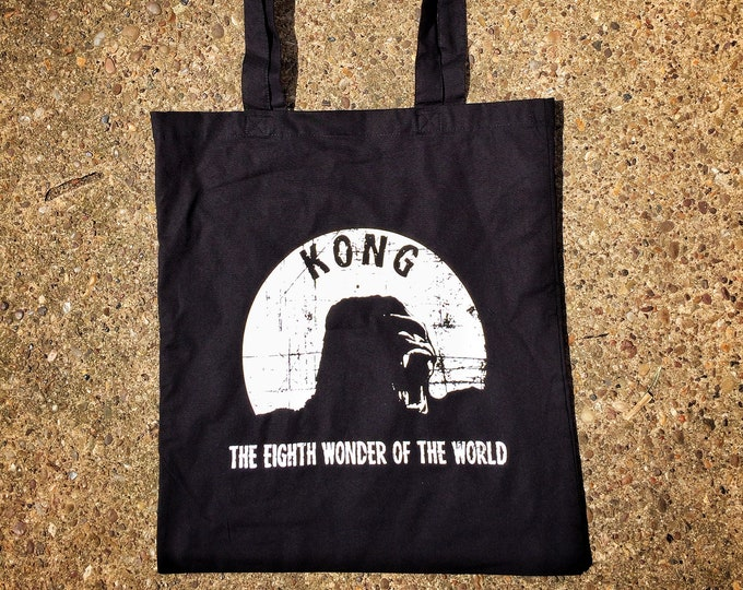 Kong tote bag, inspired by the 1933 horror movie King Kong this black tote bag from Nameless City Apparel is the ultimate bag for fans