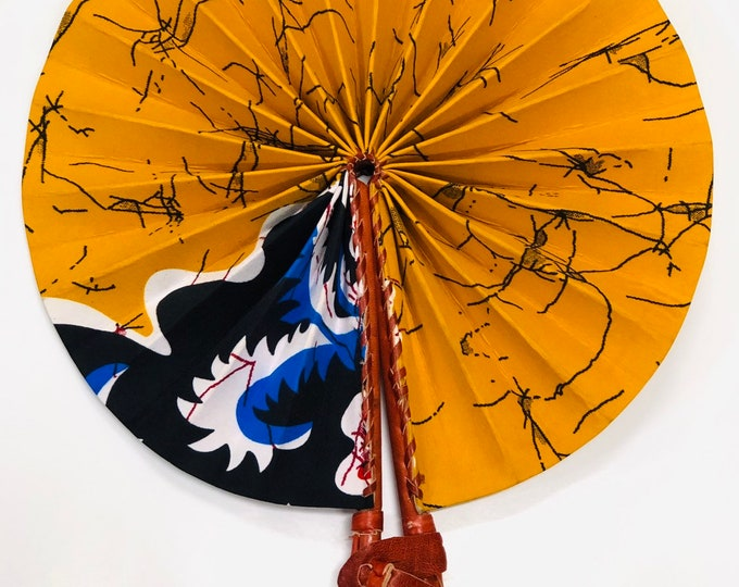 African Print Hand Holding Fan