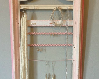 Jewelry patinated frame, lace and rickrack on display