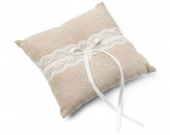 The small cushion of linen and lace wedding rings