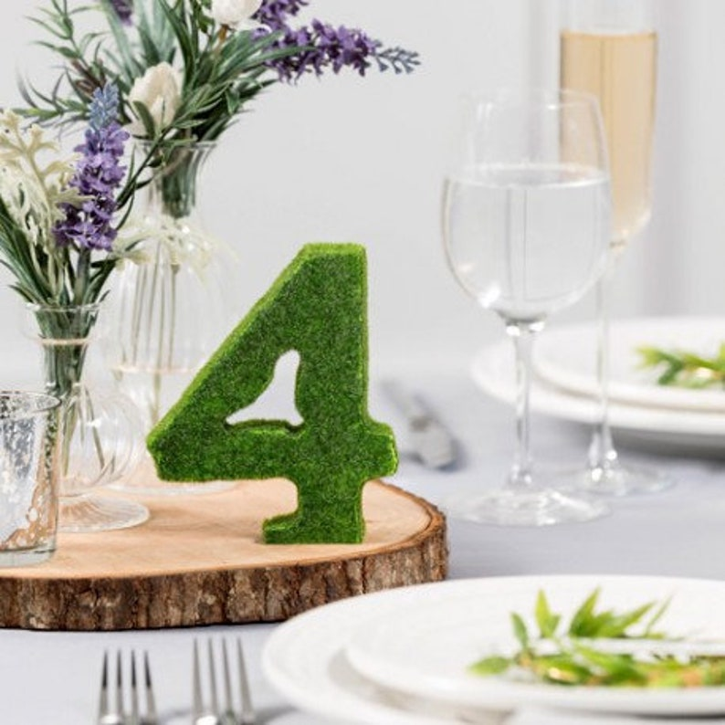 The 15 green foam table numbers