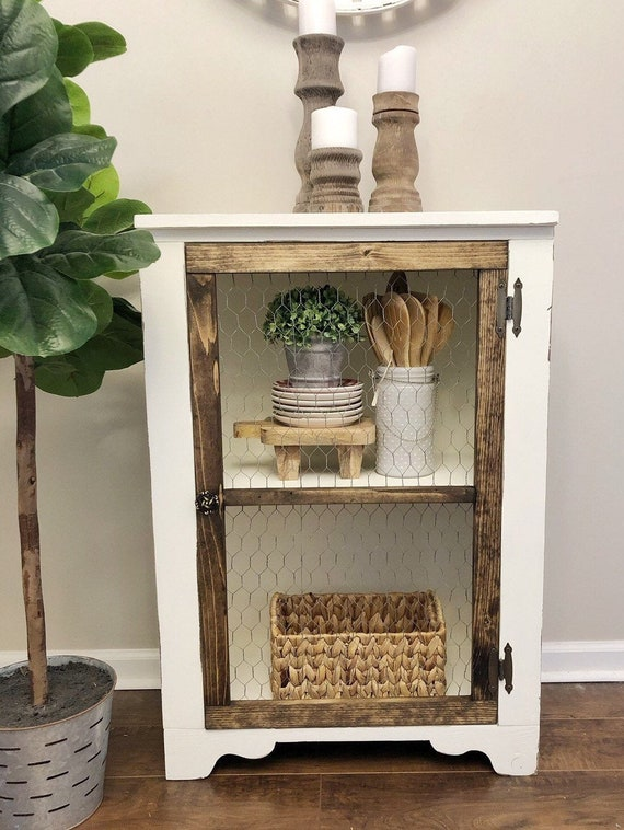 Handmade Farmhouse style cabinet with chicken wire door