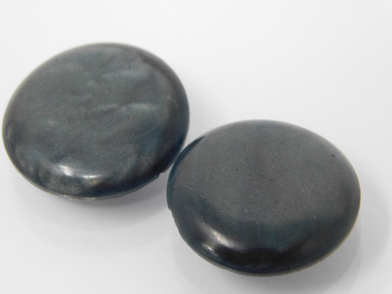 pair of vintage buttons