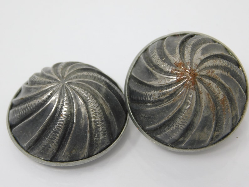 pair of silver ball buttons