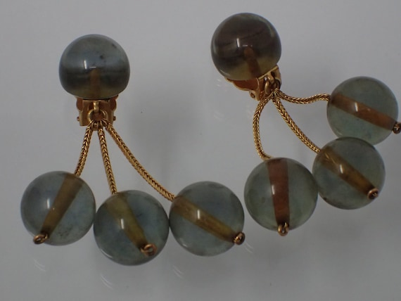 earring with blue spheres