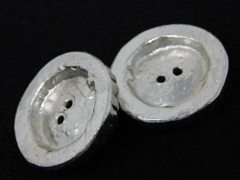 pair of vintage button in silvered bronze