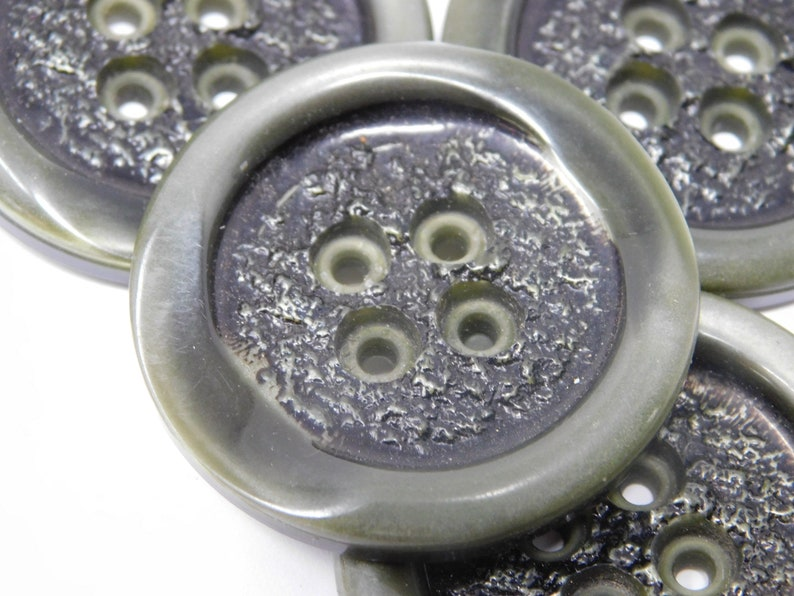 Four vintage buttons diameter 4 cm