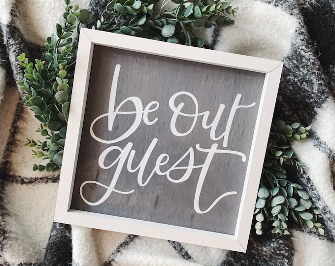 Featured listing image: Be Our Guest | Wooden Sign | Framed Sign | Rustic Farmhouse | Home Decor | Farmhouse Decor | Hand Lettered | Handmade | Gray and White